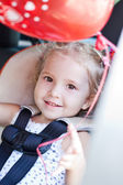 Happy toddler girl in car seat — Stock Photo