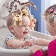 Happy baby boy playing with his sister — Stock Photo #32108027