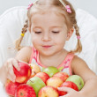 Stock Photo: Cute little girl with apple