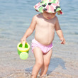 Cute baby playing on the beach — Stock Photo #33164699