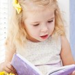 Cute little girl reading — Stock Photo #34105445