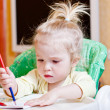 Pretty girl learning to draw with — Stockfoto