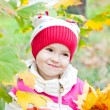 Cute little girl in autumn forest — Stock Photo