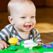 Cute baby boy playing at home — Stock Photo