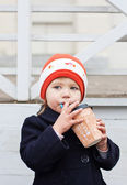 Cute little girl drinks — Stock Photo