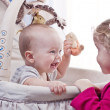 Happy baby boy playing with his sister — Stockfoto