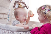 Happy baby boy playing with his sister — Stock Photo