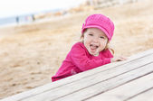 Happy little girl playing — Foto de Stock