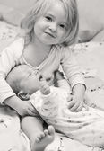 Newborn brother and little sister — Stock Photo