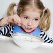 Little girl eating soup — Stock Photo