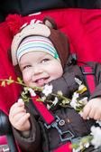 Happy baby boy in a stroller — Stock Photo