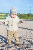 Toddler boy walking on the beach — Stock Photo
