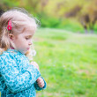 Adorable little girl blowing off dandelion — Stock Photo