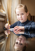 First grader girl writes — Stock Photo