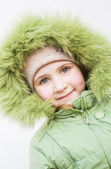 Smiling child in fur hood  — Stock Photo