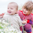 Happy children with wildflowers — Stock Photo
