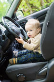 Cute baby  toddler boy in a car — Stock Photo