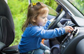 Cute little girl behind wheel  — Foto de Stock