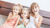 Funny children girls eating ice cream — Стоковое фото