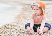 Cute toddler baby  sitting on the beach — Stock Photo
