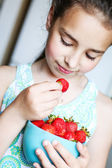 Child eating a strawberry — Stock Photo