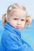 Little girl on sea — Stock Photo