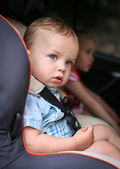 Cute toddler boy in car seat  — Stock Photo