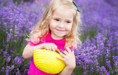 Happy little girl is in a lavender field  — Stock Photo