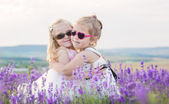 Two little girls hugging — Stock Photo