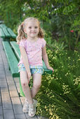 Cute little girl with broken knees — Stock Photo