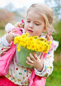 Cute little girl with dandelions — Stock Photo