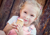 Little girl eating an ice-cream  — Foto Stock