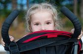 Happy little girl in a stroller — Stock Photo