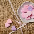 Royalty-Free Stock Photo: Heart-shaped sweets on sack tablecloth