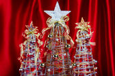 Wire Christmas Trees on Red Background — Стоковое фото