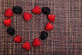 Cornice cuore bacche — Foto Stock