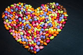 Colorful Glazed Sunflower Seed Candies Heart — Stock Photo