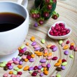 Cup of Coffee and Candies Heart — Stock Photo