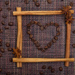 Heart of Coffee Beans in Cinnamon Sticks Frame — Stock Photo