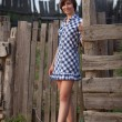 Country girl standing at the wooden fence — Stock Photo