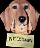 A dog statue holding a welcome sign — Stock Photo