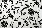 Decorative wallpaper with floral pattern in black and white — Stock Photo