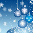 Hanging decorated blue Christmas glass balls against blue background — Stock Photo
