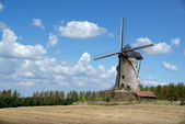 Old windmill on cloudy sky — Stock Photo