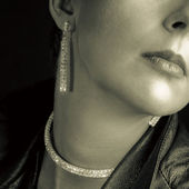 Nice woman showing sparkling earring — Stock Photo