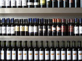 Bottles of wine in a row — Stockfoto