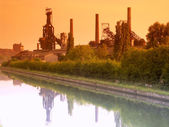 Foundry of Clabecq (now destroyed) reflecting in water. — Stock Photo