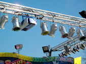 Colorful spotlights of a fair — Стоковое фото
