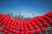 Red balls in the city — Stock Photo