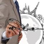 Businessman draws dream travel around the world — Stock Photo #18052789